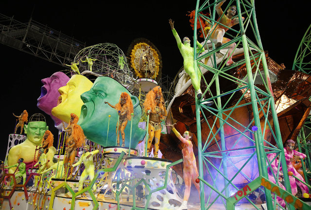 Dancers from the Tom Maior samba school perform on a float during the Carnival parade at the Sambodromo in Sao Paulo, Brazil, Friday, February 13, 2015. (Photo by Andre Penner/AP Photo)