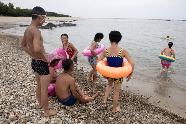 In this August 20, 2018, photo, North Koreans enjoy the day on a seashore near Mount Chilbo, North Korea. Mount Chilbo, one of the country's most cherished natural attractions, is gearing up for a future it hopes will include a lot of economic development. (Photo by Ng Han Guan/AP Photo)