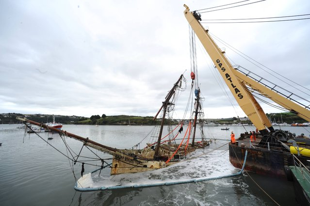 The wreck of the sail training ship the Astrid is uprighted at Lobster Quay in Kinsale, co Cork, on September 10, 2013. (Photo by Dan Linehan)