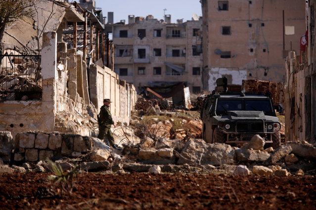 A Russian soldier walks to a military vehicle in goverment controlled Hanono housing district in Aleppo, Syria December 4, 2016. (Photo by Omar Sanadiki/Reuters)