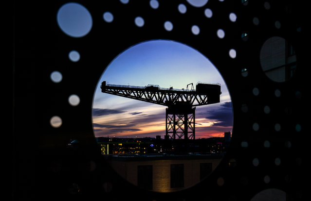Sunset behind the Finnieston Crane, one of four remaining cantilever cranes along the River Clyde in Glasgow on Sunday February 21, 2021. (Photo by Jane Barlow/PA Images via Getty Images)
