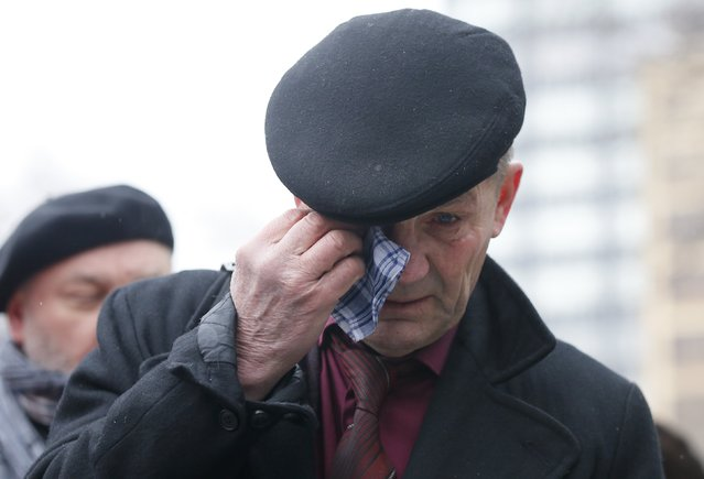 A man reacts as he waits to attend a memorial service before the funeral of Russian leading opposition figure Boris Nemtsov in Moscow, March 3, 2015. Nemtsov's girlfriend has broken her public silence on the murder of the Russian opposition activist, saying she did not see the killer who gunned him down as they strolled across a bridge near the Kremlin. Anna Duritskaya, who is 23 or 24, said she had been under constant guard since the murder and would probably be unable to attend Nemtsov's funeral on Tuesday. REUTERS/Maxim Shemetov