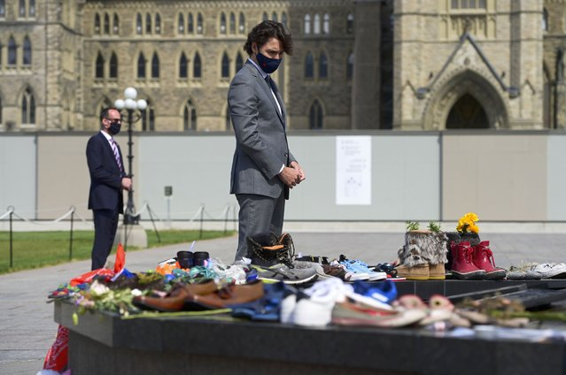 Canadian Prime Minister Justin Trudeau visits a memorial at the Eternal Flame on Parliament Hill in Ottawa on Tuesday, June 1, 2021, that's in recognition of discovery of children's remains at the site of a former residential school in Kamloops, British Columbia. (Photo by Sean Kilpatrick/The Canadian Press via AP Photo)
