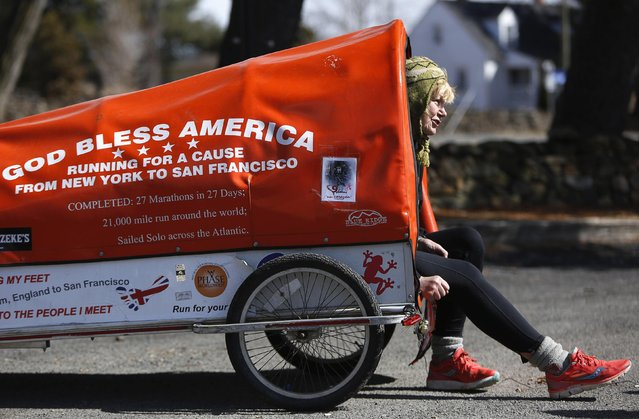 "Sixty-eight year old cross-country runner Rosie Swale-Pope is interviewed while sitting in her cart, ""The Icebird"", in Upperville, Virginia March 13, 2015. Swale-Pope, who is from Great Britain and once ran an unsupported 20,000 mile run around the globe,  is currently running across the United States from New York City to San Francisco in support of cancer research. (Photo by Gary Cameron/Reuters)"
