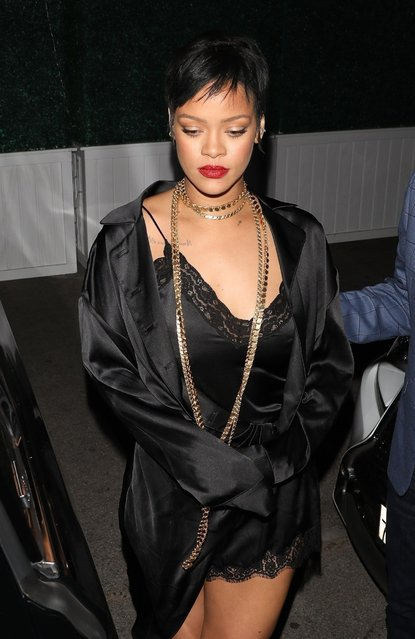 Barbadian singer Rihanna continues to rock her nostalgic look with her edgy short pixie cute while out with friends at Delilah Nightclub in West Hollywood on June 7, 2021. Rihana made sure to turn heads as she put on a sultry display in a black silk lingerie dress with a matching robe. (Photo by Backgrid USA)