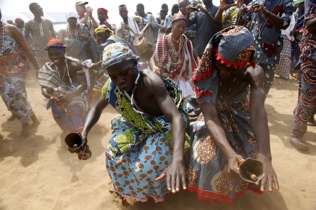 BENIN: Devotees perform at the annual voodoo festival in Ouidah in Benin, January 10, 2016. In Ouidah, a small town and former slave port in the West African country of Benin, the annual voodoo festival gathers visitors from far and wide. It's a week that brings together priests and dignitaries, rich and poor, locals and visitors from as far afield as the Caribbean and France. The festival commemorates the estimated 60 million people who lost their homelands and their freedom during the African slave trade. (Photo by Akintunde Akinleye/Reuters)
