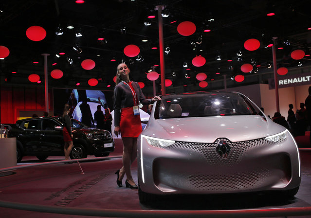 A model poses next to a Renault Eolab concept car on display at the Indian Auto Expo in Greater Noida, on the outskirts of New Delhi, India, February 3, 2016. (Photo by Anindito Mukherjee/Reuters)