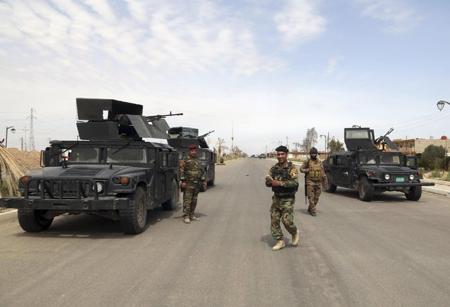 Iraqi security forces deploy in Tikrit, 80 miles (130 kilometers) north of Baghdad, Iraq, Wednesday, April 1, 2015. (Photo by Khalid Mohammed/AP Photo)