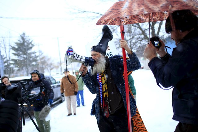 Vermin Supreme talks through a bullhorn at the bus carrying U.S. Republican presidential candidate Ted Cruz at a campaign event in Manchester, New Hampshire February 8, 2016. (Photo by Eric Thayer/Reuters)