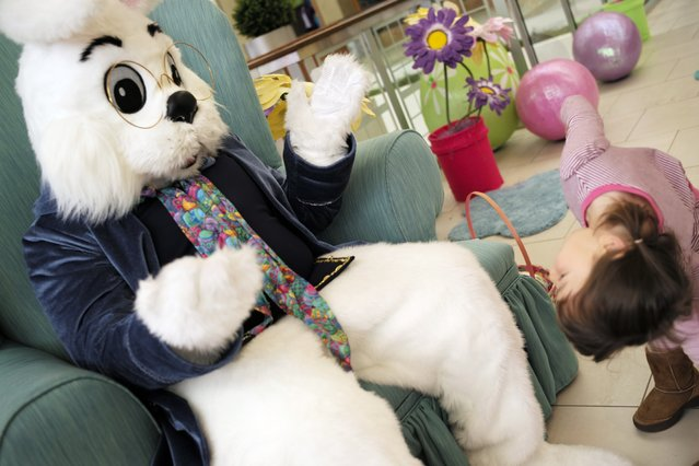 At Southdale Center in Edina, the Easter Bunny, a.k.a. Ryan Eide played peekaboo with Caroline Phan, 4, of Richfield who got a kick out of the meet and greet. (Photo by Richard Tsong-Taatarii/Star Tribune)
