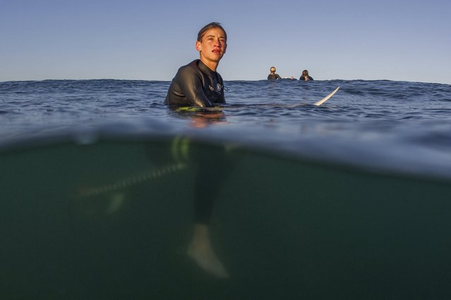 Luke Personius, 12, waits for a wave as he surfs before school at sunrise in Hermosa Beach, California April 2, 2015. (Photo by Lucy Nicholson/Reuters)