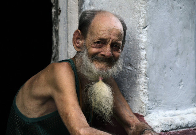A man sits at the door of his home in Havana, Cuba,  August 2010. (Photo by Desmond Boylan/Reuters)
