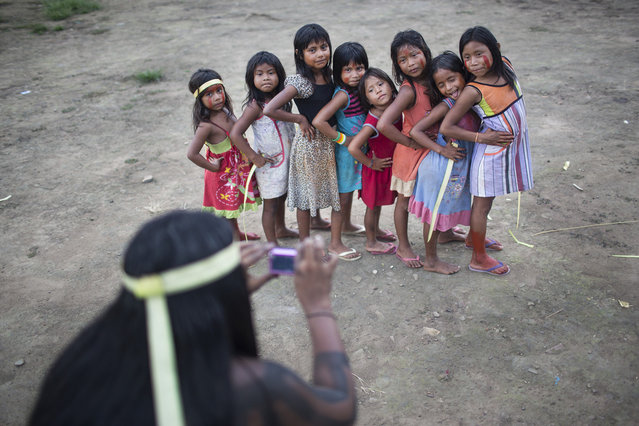 Xikrin girls pose as a group during a day of celebration and traditional dances. (Taylor Weidman)
