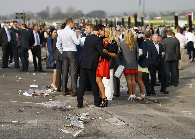 Horse Racing – Crabbie's Grand National Festival – Aintree Racecourse April 10, 2015: A couple kiss at the end of the day. (Photo by Darren Staples/Reuters)