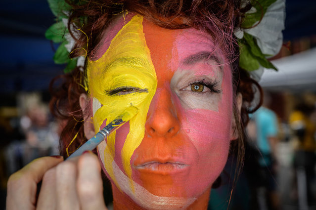 """Participant Tricia Storie poses for a portrait after being painted during the annual NYC Bodypainting Day at Union Square in New York on July 25, 2021. The annual self-titled event aims to promote acceptance and the """"use of the human form as an aesthetic versus personal identity"""". (Photo by Ed Jones/AFP Photo)"""