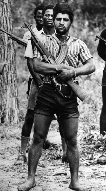 Fighters of the UNITA pro-Western forces armed with a local variant of the AK-47 Kalashnikov during the civil war in Angola, 1977. (Photo by Cloete Breytenbach/Getty Images)
