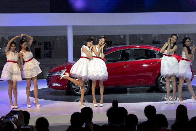 Taiwanese performers introduce a new car from Luxgen, a joint venture between state-owned Dongfeng Motor Co. and Yukon, a Taiwanese partner in Shanghai, Monday, April 20, 2015. (Photo by Ng Han Guan/AP Photo)