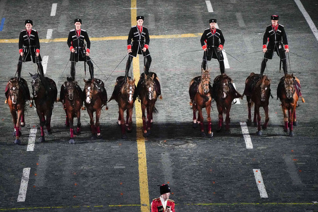 Russian soldiers ride they horses performing during the Spasskaya Tower International Military Music Festival in Red Square in Moscow, Russia, Thursday, August 26, 2021. (Photo by Alexander Zemlianichenko/AP Photo)