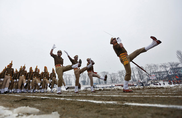 Indian policemen march during India's Republic Day parade on a cold winter day in Srinagar January 26, 2017. (Photo by Danish Ismail/Reuters)