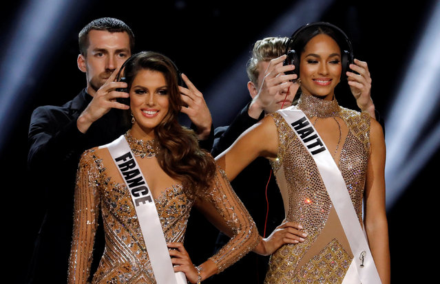 Headphones are placed on Miss France Iris Mittenaere (L) and Miss Haiti Racquel Pellisier during the question and answer portion at the 65th Miss Universe beauty pageant at the Mall of Asia Arena, in Pasay, Metro Manila, Philippines January 30, 2017. (Photo by Erik De Castro/Reuters)