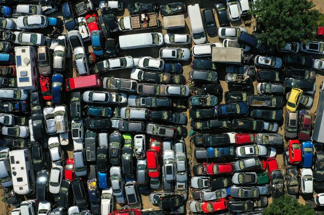 An aerial view shows cars damaged by the floods at a collection point in Bad Neuenahr, western Germany on August 25, 2021, weeks after heavy rain and floods caused major damage in the Ahr region. (Photo by Ina Fassbender/AFP Photo)