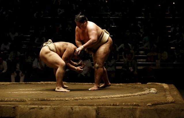 Sumo wrestlers Takayasu (L) and Mongolian-born Ichinojo work out during their joint training session for Nishonoseki clan ahead of the May Grand Sumo Tournament in Tokyo May 2, 2015. (Photo by Toru Hanai/Reuters)
