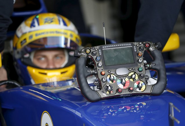 Formula One, Australia Grand Prix, Melbourne, Australia on March 19, 2016: Sauber F1 driver Marcus Ericsson sits in his car alongside his steering wheel during the third practice session at the Australian Formula One Grand Prix in Melbourne. (Photo by Brandon Malone/Reuters)