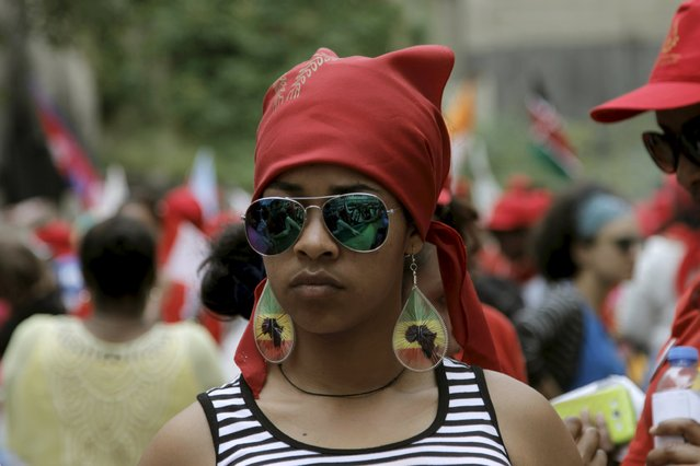 An Ethiopian migrant domestic worker attends a parade in Beirut, to support the rights of migrant domestic workers in Lebanon and calling for a domestic workers union in Beirut May 3, 2015. (Photo by Alia Haju/Reuters)