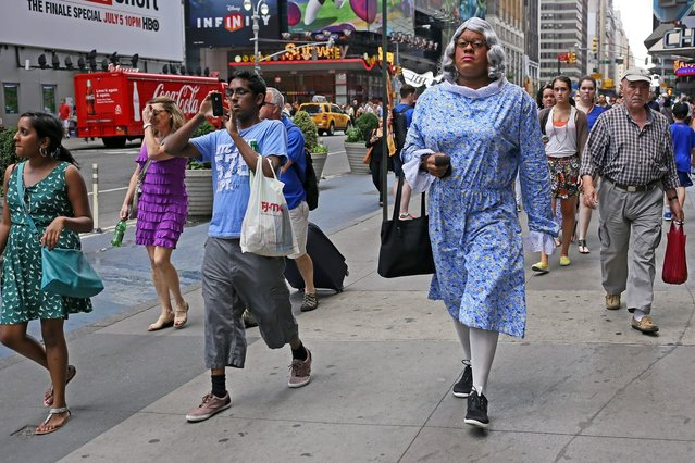 """Madea wannabe struts her stuff through midtown..."" (Rich Docherty)"