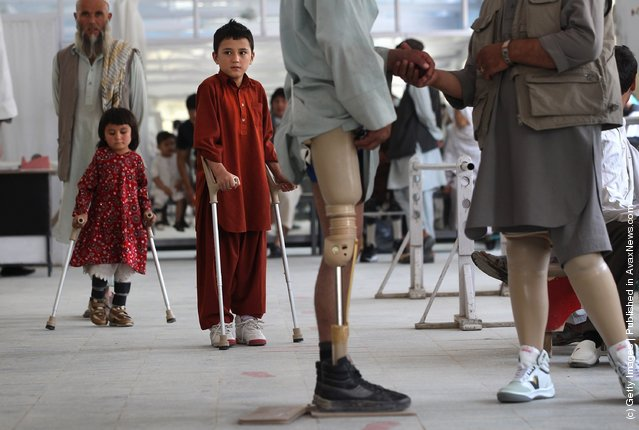 Afghan war amputees and children practice walking at the International Committee of the Red Cross (ICRC), orthopedic center