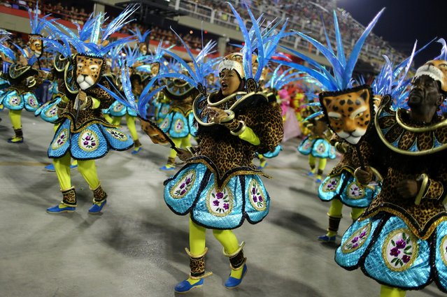 Revellers from Sao Clemente samba school perform during the second night of the carnival parade at the Sambadrome in Rio de Janeiro, Brazil February 27, 2017. (Photo by Pilar Olivares/Reuters)