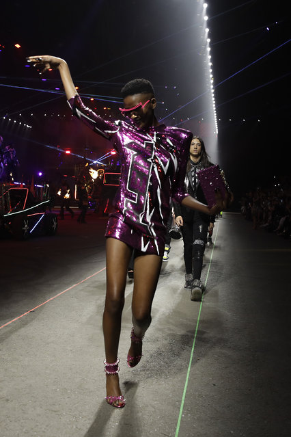 A model wears a creation as part of the Plein men's Spring-Summer 2020 collection, unveiled during the fashion week, in Milan, Italy, Saturday, June 15, 2019. (Photo by Luca Bruno/AP Photo)