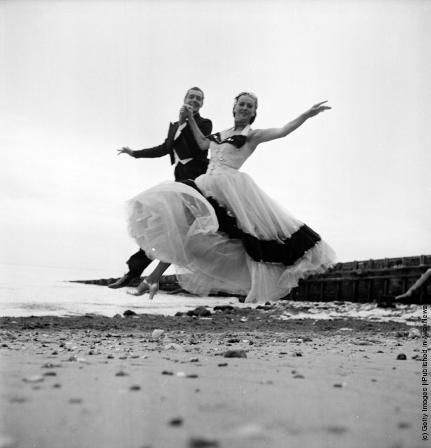 1953: Television dancing duo Boyer and Ravel, dancing on the beach at Eastbourne, East Sussex, where they have been spending the summer