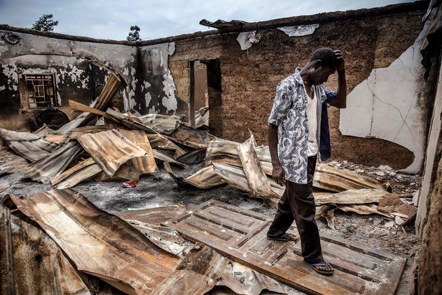 An Adara farmer visits an area of destroyed and burned houses after a recent Fulani attack in the Adara farmers' village of Angwan Aku, Kaduna State, Nigeria, on April 14, 2019. The ongoing strife between Muslim herders and Christian farmers, which claimed nearly 2,000 lives in 2018 and displaced hundreds of thousands of others, is a divisive issue for Nigeria and some other countries in West Africa. (Photo by Luis Tato/AFP Photo)