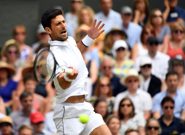 Serbia's Novak Djokovic is seen in action during his semi-final match against Spain's Roberto Bautista Agut at Wimbledon's All England Lawn Tennis and Croquet Club, London, Britain on July 12, 2019. (Photo by Andy Rain/Pool via Reuters)