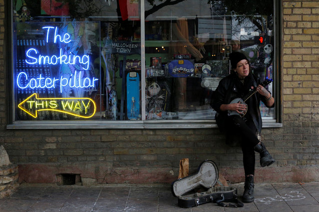 Sam Allen performs on a street corner on 6th Street during the South by Southwest Music Film Interactive Festival 2017 in Austin, Texas, U.S., March 13, 2017. (Photo by Brian Snyder/Reuters)