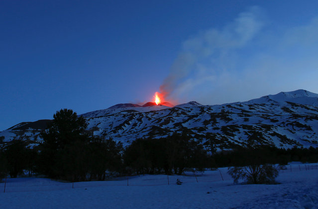 Italy's Mount Etna, Europe's tallest and most active volcano, spews lava as it erupts on the southern island of Sicily, Italy February 28, 2017. (Photo by Antonio Parrinello/Reuters)