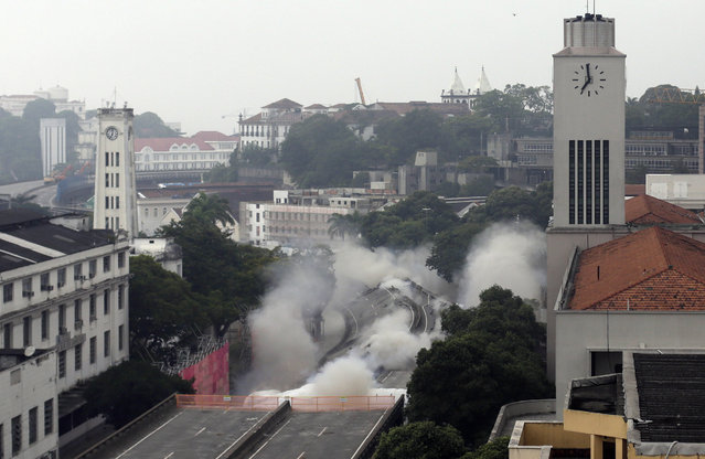 Explosives are detonated to demolish part of the Perimetral overpass, as part of Rio's Porto Maravilha (Marvelous Port) urbanisation project, in Rio de Janeiro April 20, 2014. The project is for the city's redevelopment ahead of the 2016 Olympic Games. (Photo by Ricardo Moraes/Reuters)