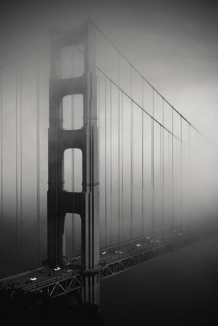 """""""Golden Gate Bridge in the fog"""". This photo was taken in April 2014. Just one minute before, the Golden Gate Bridge was entirely hidden in the fog. Photo location: San Francisco, California. (Photo and caption by Solene Peralta/National Geographic Photo Contest)"""