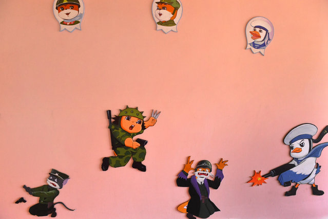 Characters on the walls of a day care center / preschool center at what North Korea authorities say was a Jangchon cooperative farm on the outskirts of  Pyongyang, North Korea on May 4, 2016. The homes had vegetable gardens in the front, solar panels on the roofs but didn't appear to be very populated. (Photo by Linda Davidson/The Washington Post)