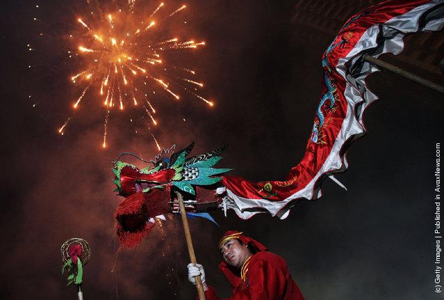 An athlete performs a Dragon Dance during Lantern Festival celebrations