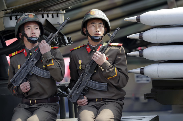 North Korean soldiers on mobile missile launchers are paraded across Kim Il Sung Square during a military parade on Saturday, April 15, 2017, in Pyongyang, North Korea to celebrate the 105th birth anniversary of Kim Il Sung, the country's late founder and grandfather of current ruler Kim Jong Un. (Photo by Wong Maye-E/AP Photo)