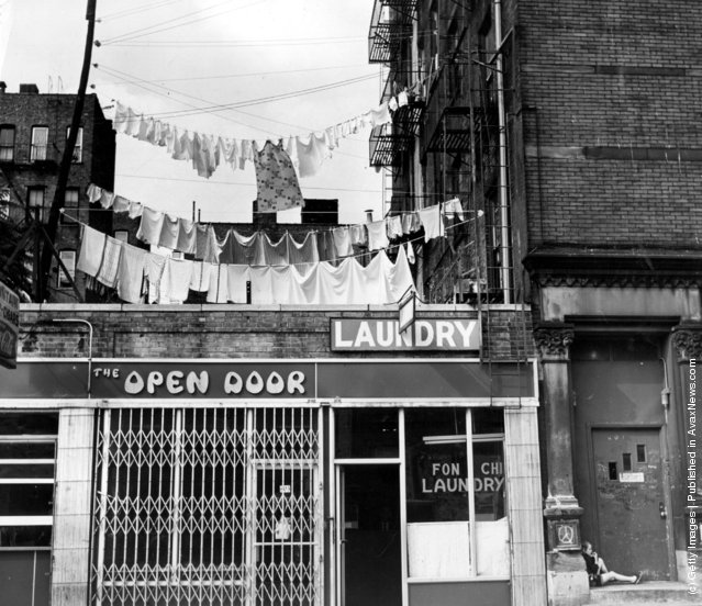 1977:  Clean washing hanging out to dry above a laundry one block west of the more glamorous Times Square, New York