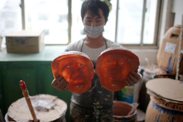 A worker checks masks of U.S. Republican presidential candidate Donald Trump at Jinhua Partytime Latex Art and Crafts Factory in Jinhua, Zhejiang Province, China, May 25, 2016. (Photo by Aly Song/Reuters)