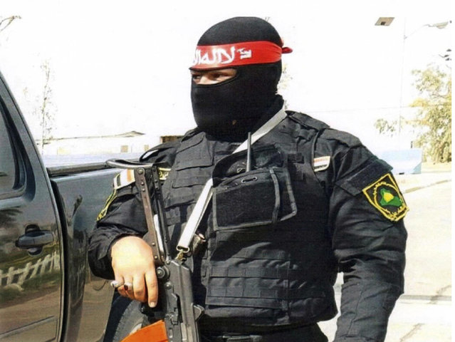 """This undated photo obtained by the Associated Press shows an Iraqi bodyguard hired by Sallyport Global to protect VIPs. When a Toyota SUV was stolen from Balad air base, he became the chief suspect and was linked to a dangerous Iran-backed militia and was viewed by investigators as """"a hard-core recruit to become a terrorist who poses a serious threat to all personnel on this base"""". (Photo via AP Photo)"""