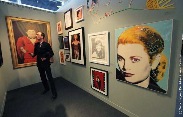 A visitor views works at the Chowaiki & Co. exhibitor booth at The Armory Show, New York's annual international art fair