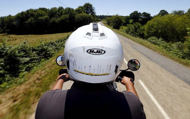 The stage map is seen on the back of the helmet of the Reuters motorbike driver as he rides during the 7th stage of the 102nd Tour de France cycling race from Livarot to Fougeres, France, July 10, 2015. (Photo by Stefano Rellandini/Reuters)