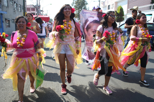 Activist Diana Ceballos, second left, takes part in a procession for felled women like her 14-year old cousin, in Ecatepec, a suburb of Mexico City, Saturday, November 23, 2019. Ceballos' cousin was raped and stabbed to death by an ex-boyfriend of the teenager's mother. He confessed via text message to the mother immediately after the 2014 murder. Even so, it took three years to clinch a jail sentence against the perpetrator. (Photo by Alicia Fernandez/AP Photo)