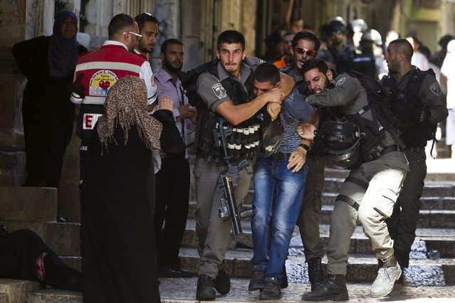 Israeli border police officers detain a Palestinian protester in Jerusalem's Old City, on Tisha B'Av July 26, 2015. (Photo by Amir Cohen/Reuters)