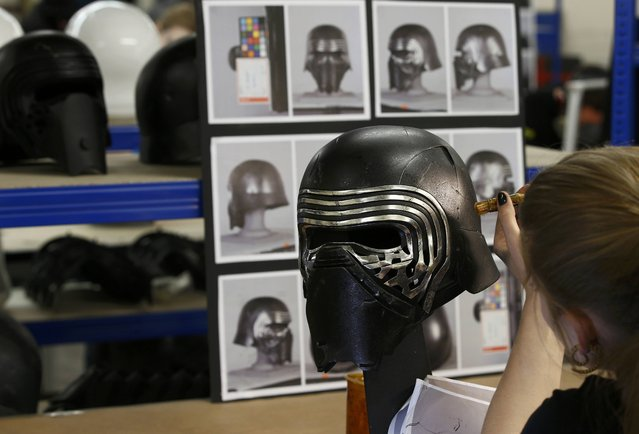 A technician at Propshop adds finishing touches to a replica of Kylo Ren's Helmet from Star Wars:  The Force Awakens, at the company's workshop at Pinewood studios near London, Britain May 25, 2016. (Photo by Peter Nicholls/Reuters)